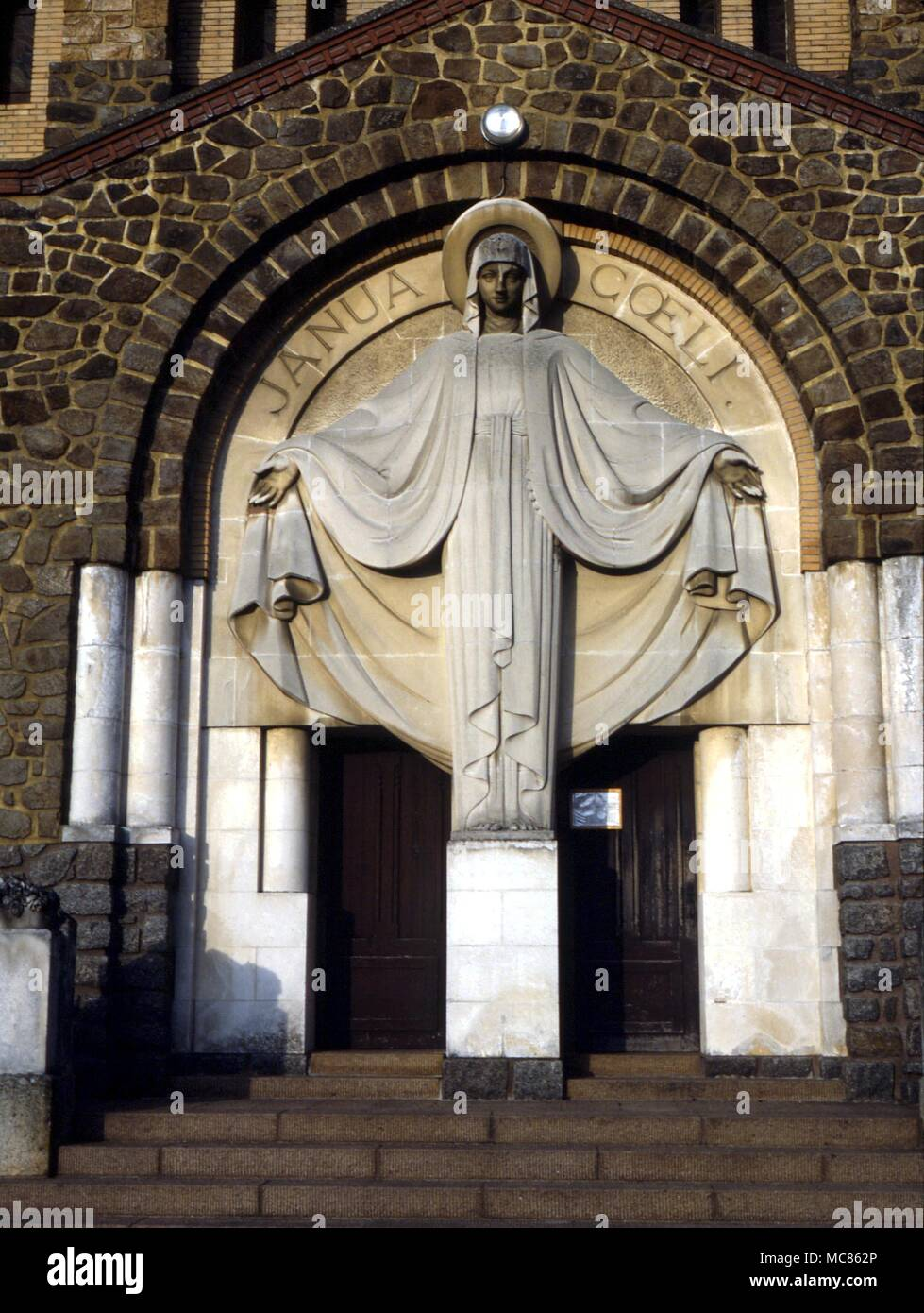 Christian Symbols The Image Of The Virgin Mary Over The Entrance To