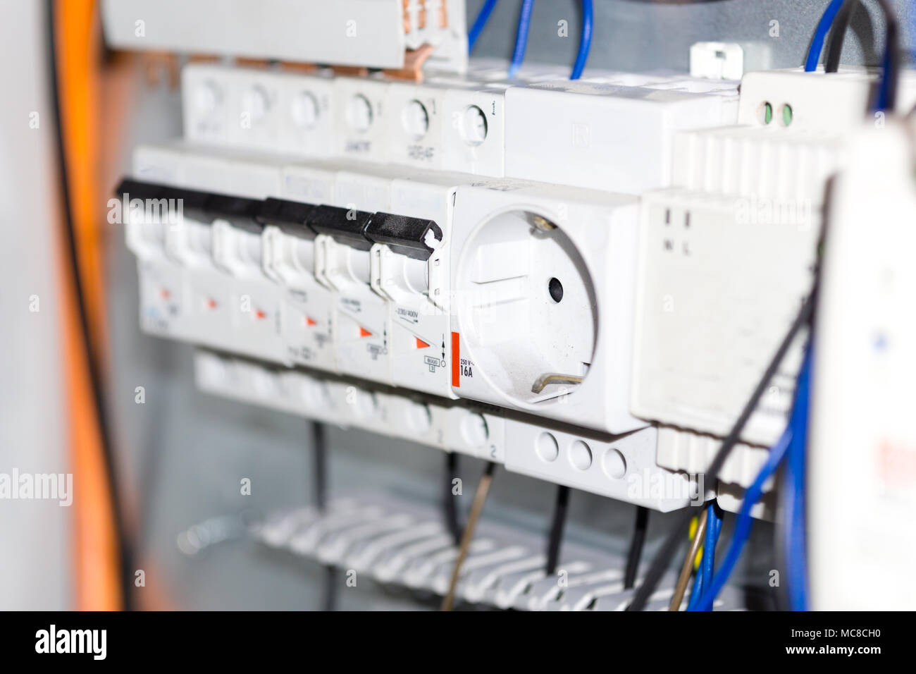 Electrical equipment components installation in fuse box. Wiring and  connections.