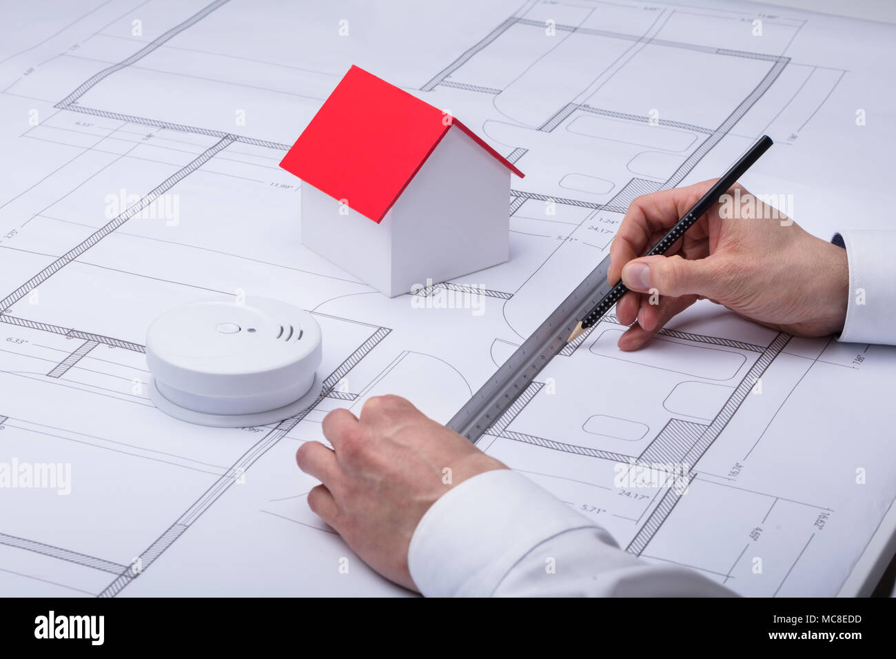 Architecture Drawing Blueprint Near Smoke Detector And House Model - Stock Image