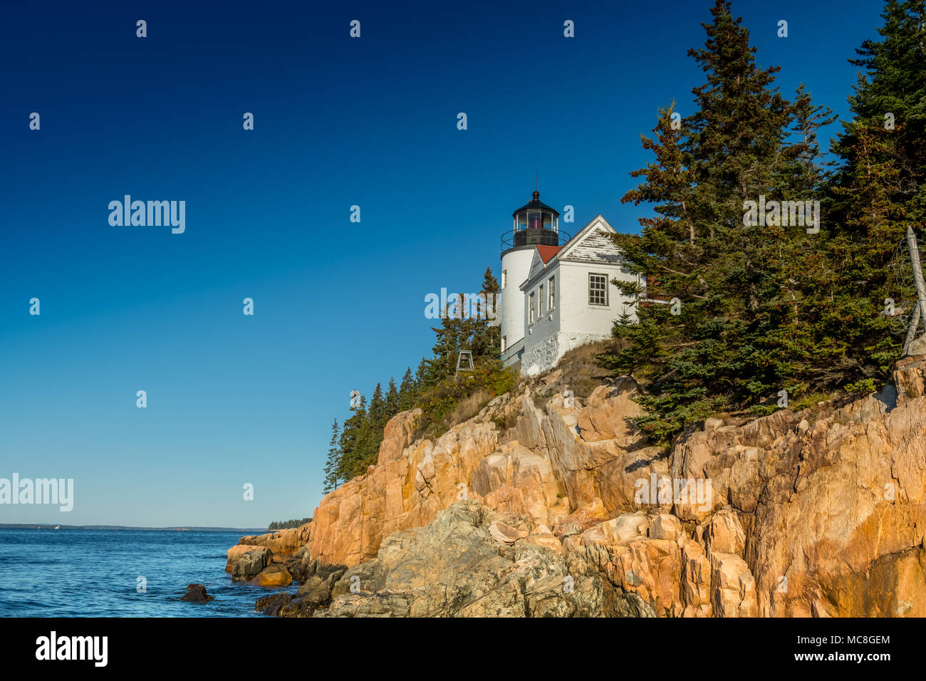 Shooting Up at Bass Harbor Lighthouse on sunny morning - Stock Image