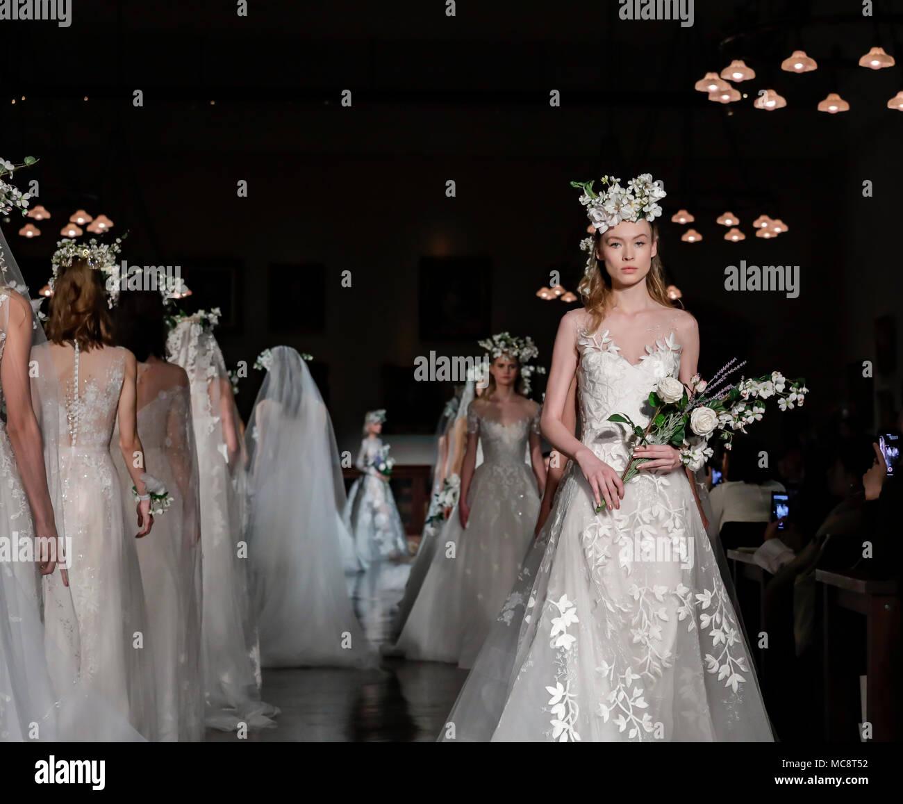 New York, NY, USA - April 12, 2018: Models walk runway for Reem Acra Bridal Spring/Summer 2019 collection during NY Bridal Wweek at NY Public Library, - Stock Image