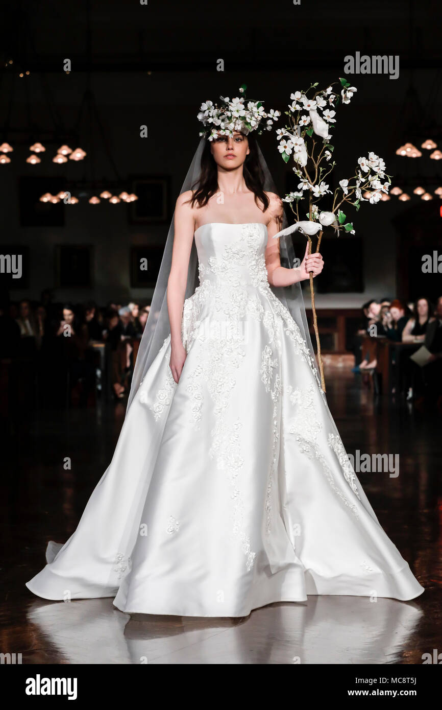New York, NY, USA - April 12, 2018: A model walks runway for Reem Acra Bridal Spring/Summer 2019 collection during NY Bridal Wweek at NY Public Librar - Stock Image