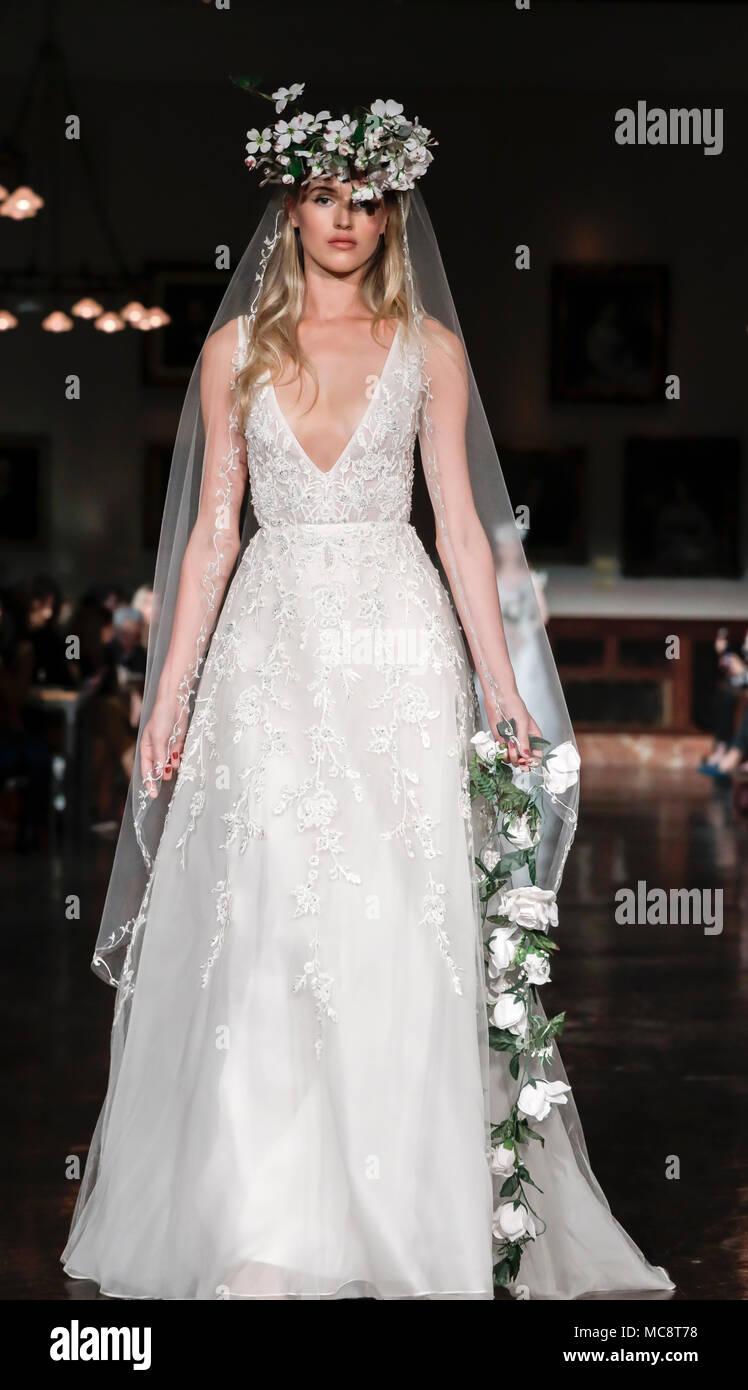New York, NY, USA - April 12, 2018: A model walks runway for Reem Acra Bridal Spring/Summer 2019 rcollection during NY Bridal Wweek at NY Public Libra - Stock Image