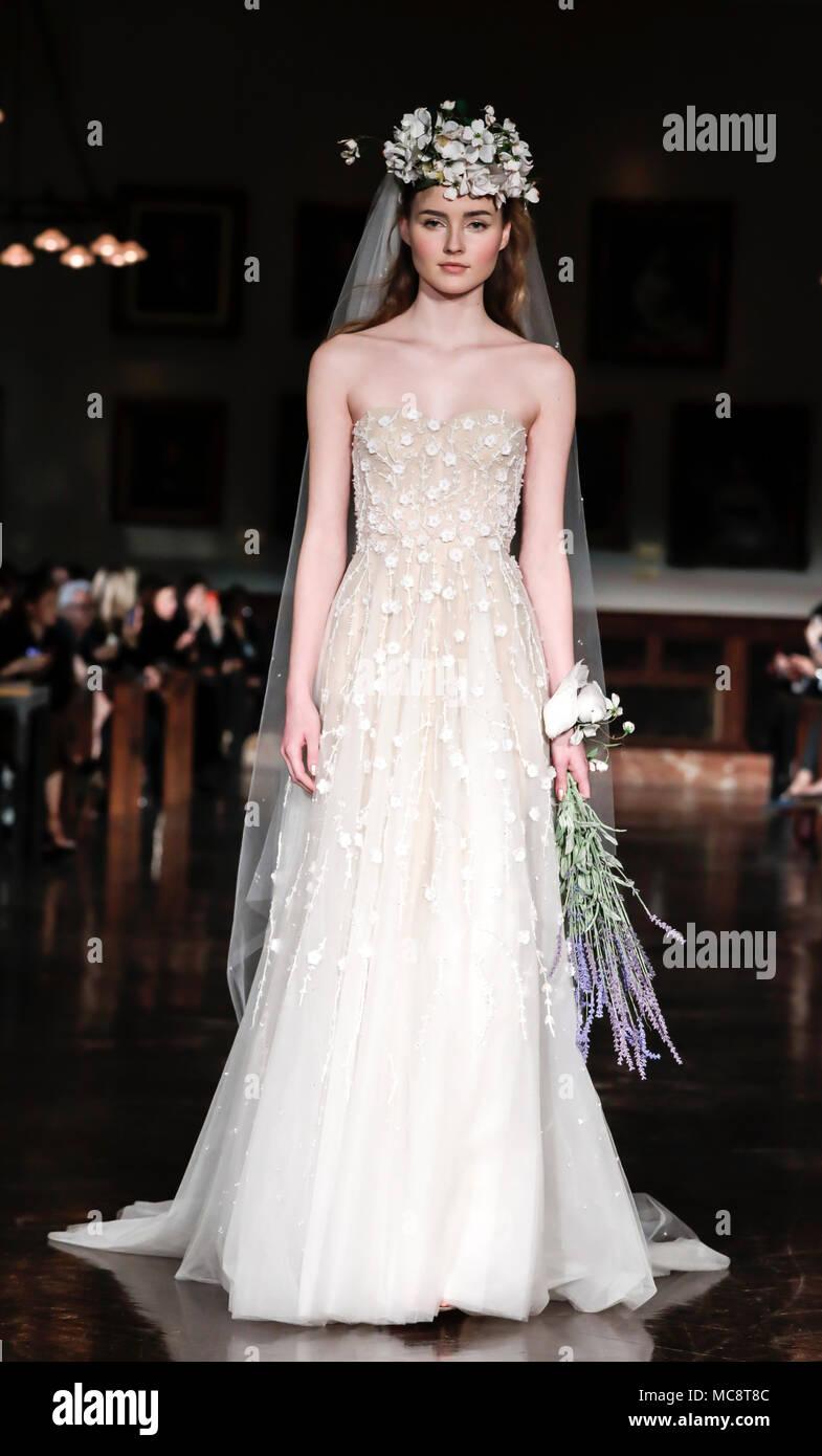 New York, NY, USA - April 12, 2018: A model walks runway for Reem Acra Bridal Spring/Summer 2019 runway show during NY Bridal Wweek at NY Public Libra - Stock Image