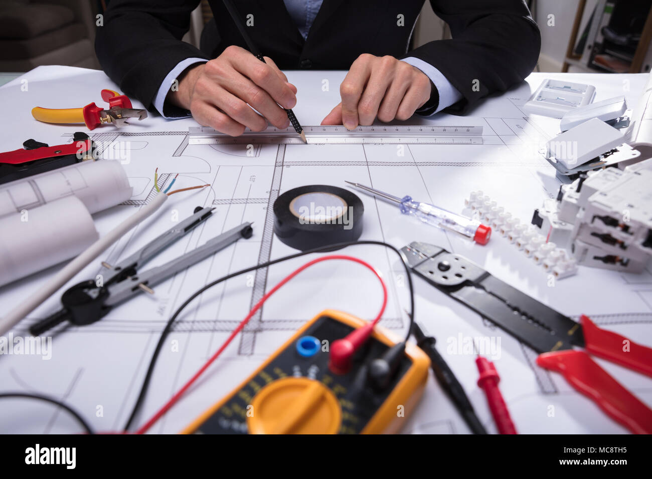 Close-up Of Various Worktools In Front Of Architecture's Hand Drawing Blueprint - Stock Image