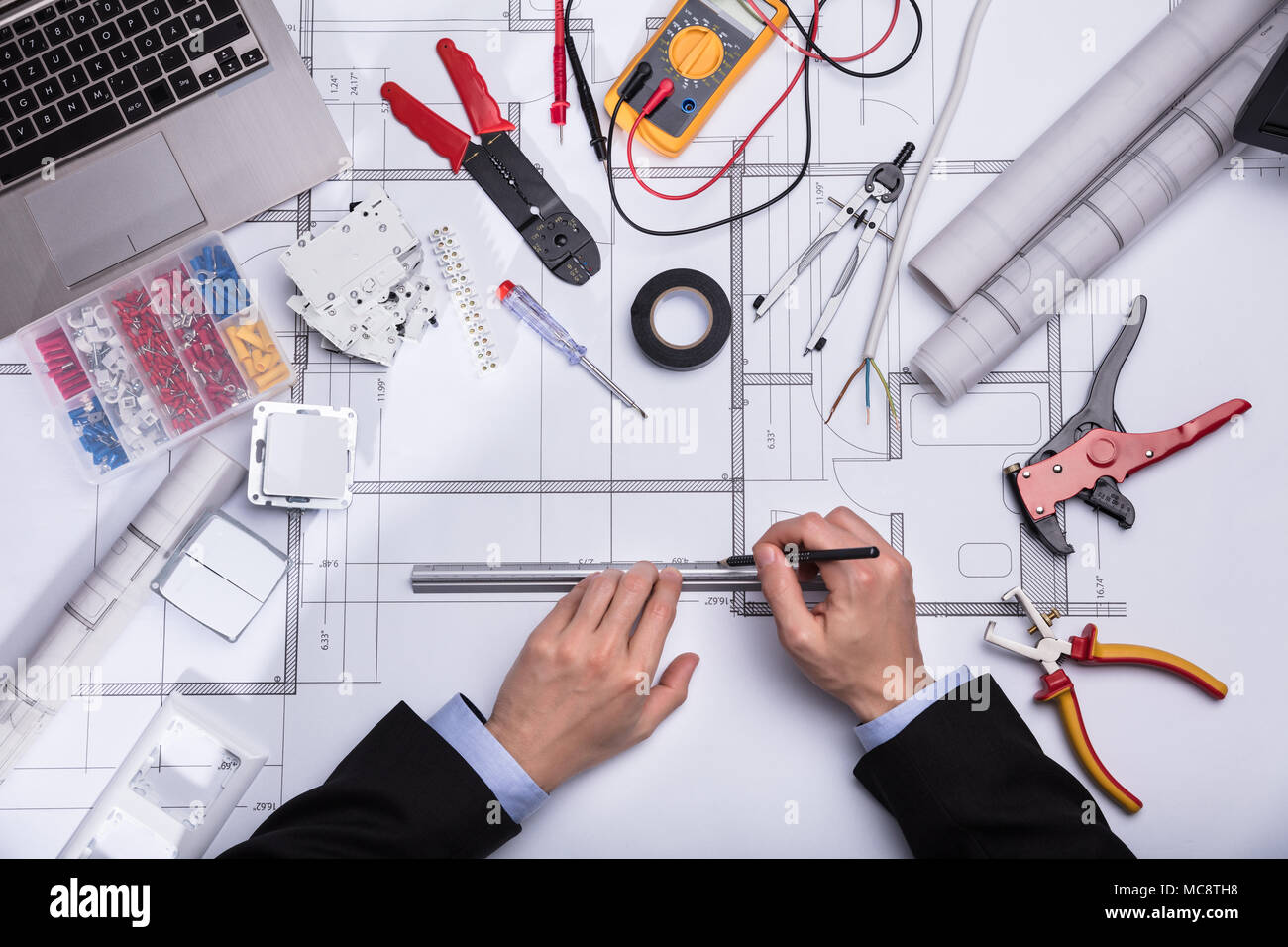High Angle View Of A Architect's Hand Drawing Blueprint With Pencil - Stock Image