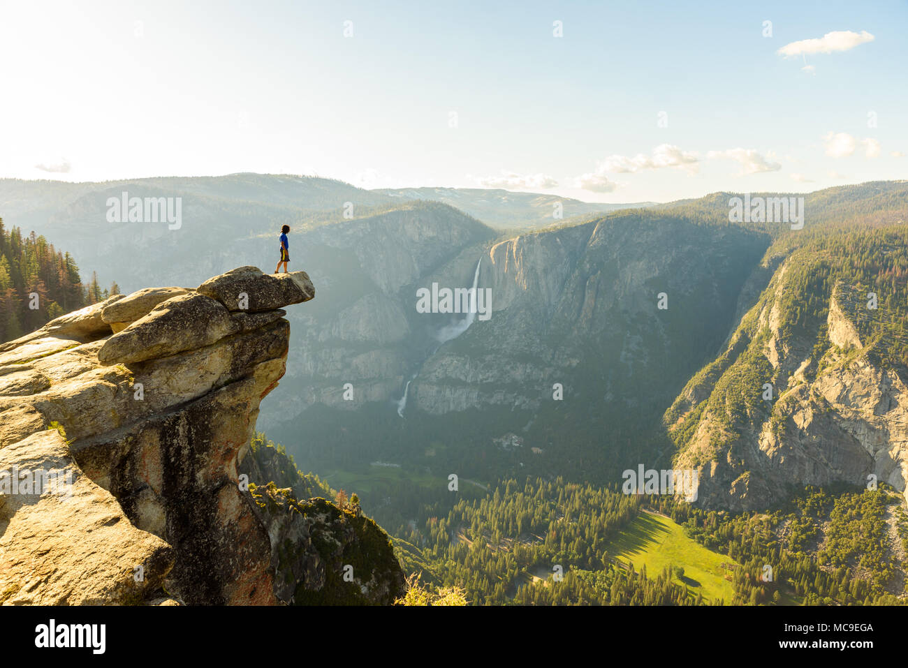 Hiker at the Glacier Point with View to Yosemite Falls and Valley in the  Yosemite National Park, California, USA