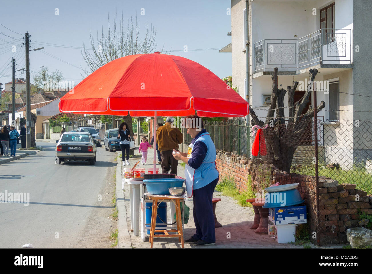 Elhovo, Bulgaria, 14 April 2018. Selling donuts on a street corner  on a bright sunny warm day. Clifford Norton Alamy Live News. - Stock Image