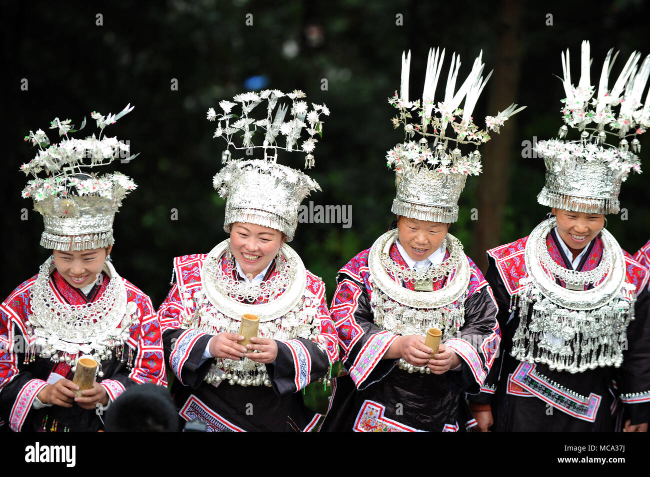 Jianhe, China's Guizhou Province. 14th Apr, 2018. People of Miao ethnic group sing love songs during a celebration of the Love Song Festival in Jianhe County in Qiandongnan Miao and Dong Autonomous Prefecture, southwest China's Guizhou Province, April 14, 2018. People of the Miao ethnic group celebrated their Love Song Festival here on Saturday. Credit: Yang Wenbin/Xinhua/Alamy Live News - Stock Image