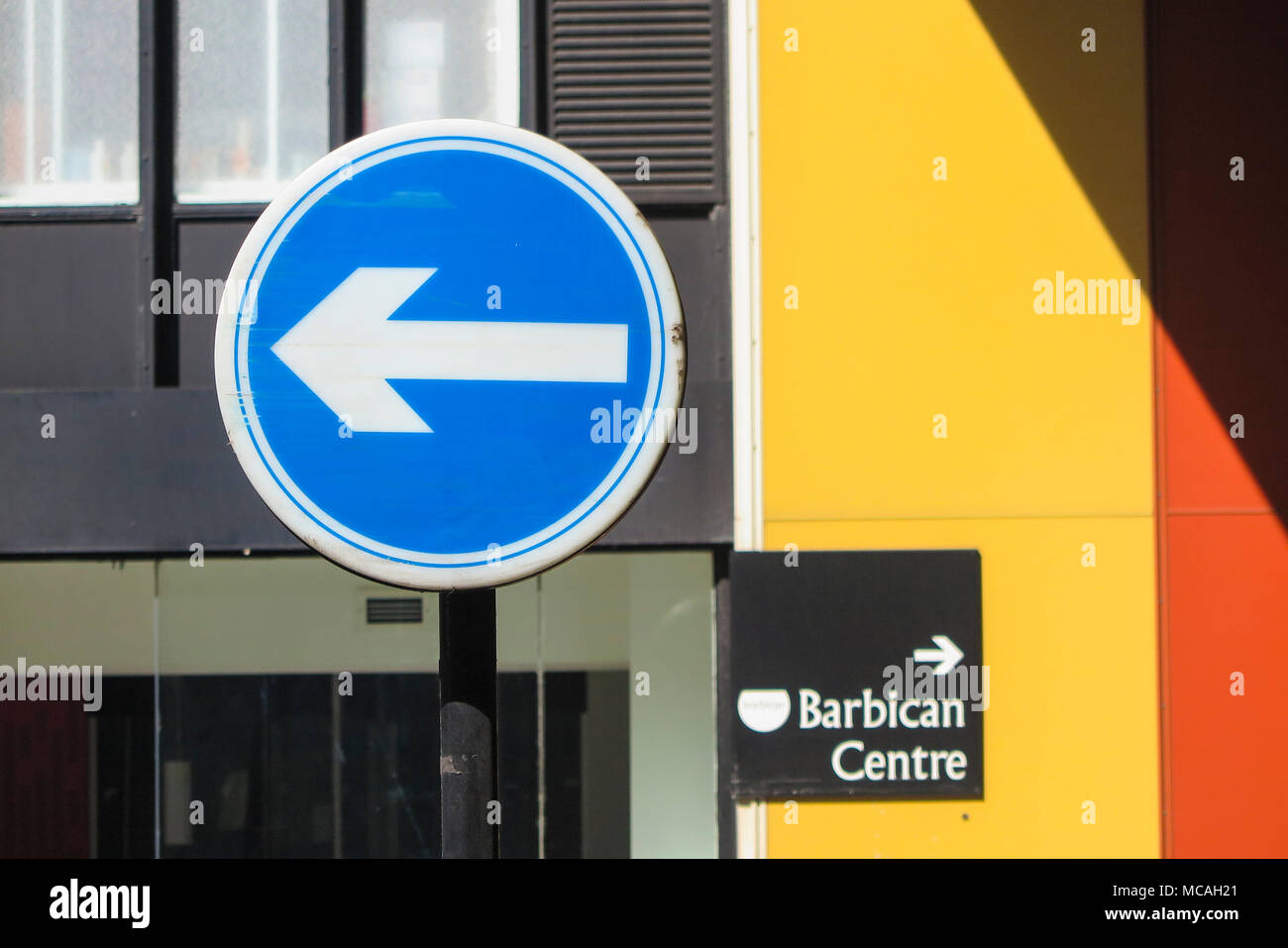 A one way sign to the left and a sign towards the Barbican Centre on the right - Stock Image