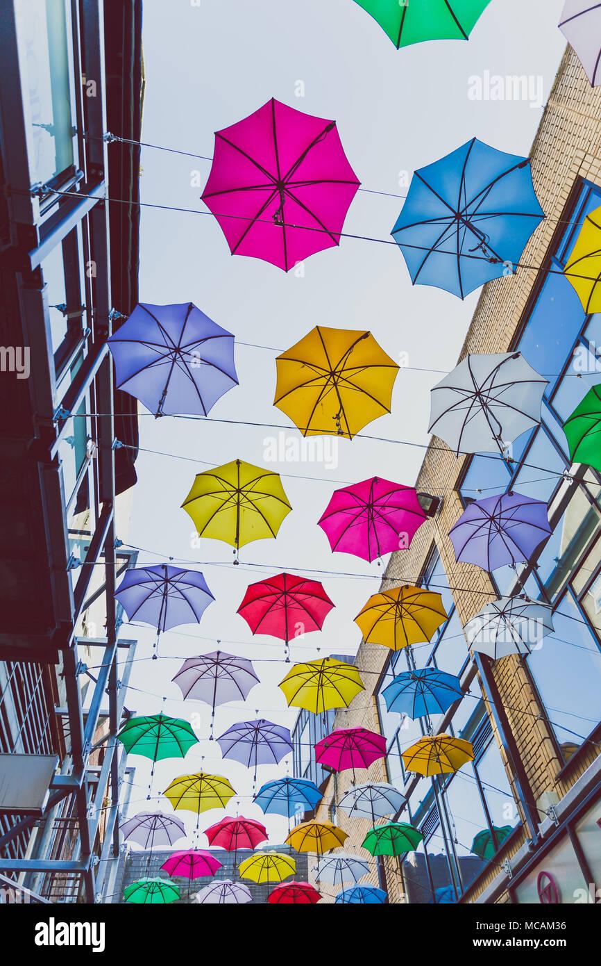 DUBLIN, IRELAND - April 14th, 2018: colorful umbrellas art installation in frot of the Zozimus bar in Dublin city centre - Stock Image