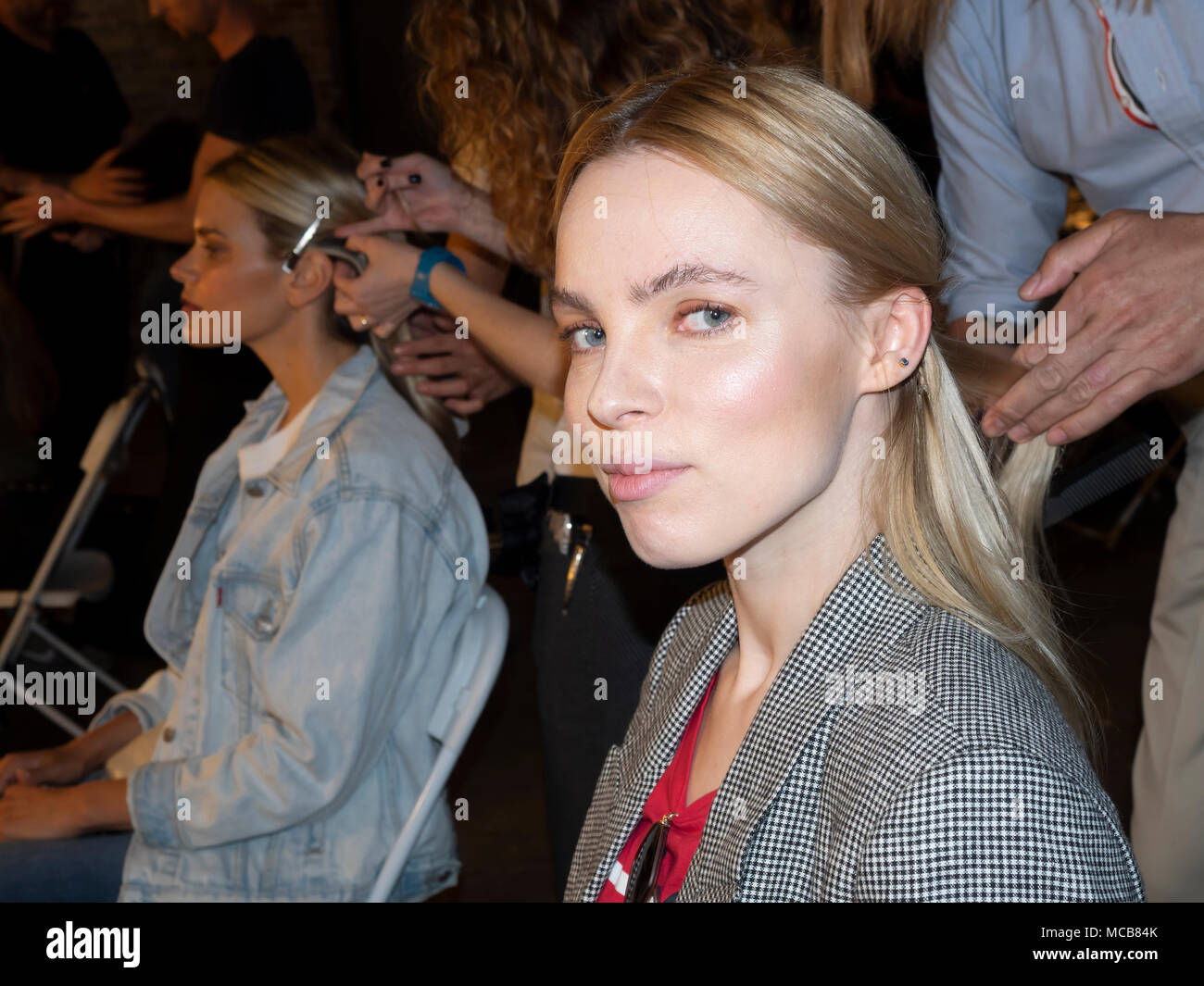 NEW YORK, NY, USA - APRIL 14, 2018: A model prepares backstage for Adam Zohar collection during New York Bridal Week at Industria, Manhattan Credit: Sam Aronov/Alamy Live News - Stock Image