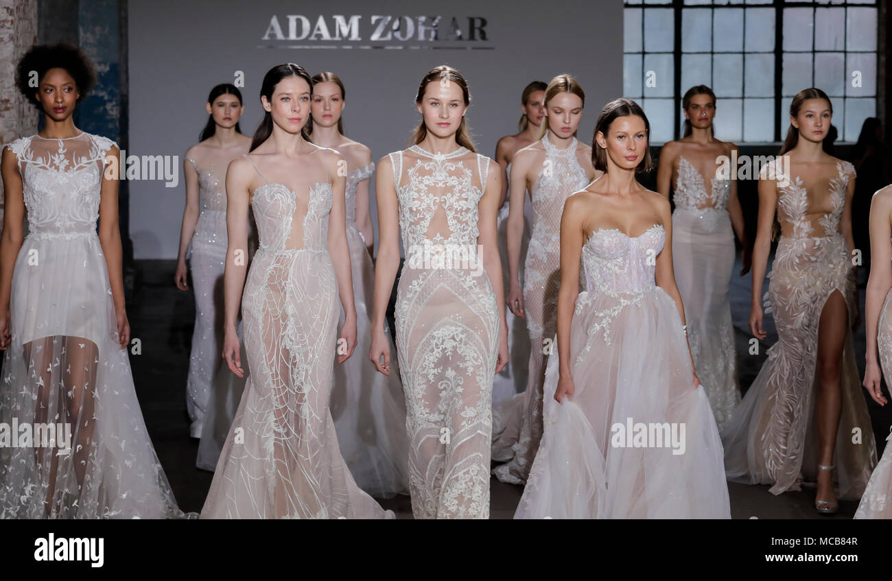 NEW YORK, NY, USA - APRIL 14, 2018: Models walk the runway for Adam Zohar collection during New York Bridal Week at Industria, Manhattan Credit: Sam Aronov/Alamy Live News - Stock Image