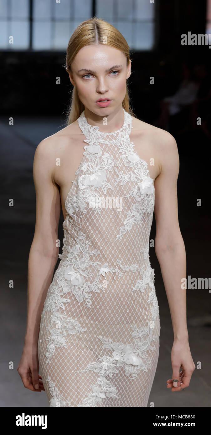 NEW YORK, NY, USA - APRIL 14, 2018: A model walks the runway for Adam Zohar collection during New York Bridal Week at Industria, Manhattan Credit: Sam Aronov/Alamy Live News - Stock Image