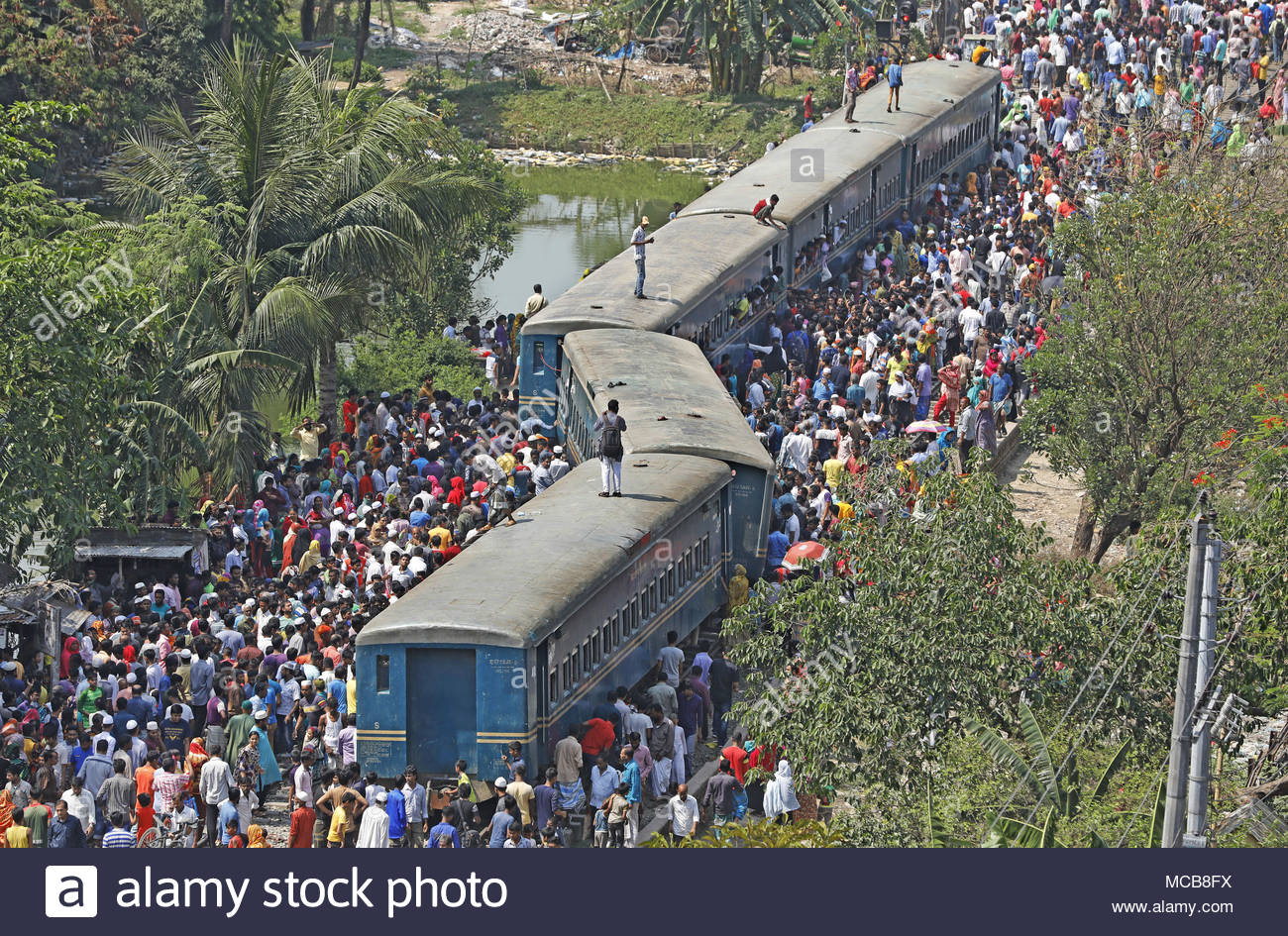 Tongi, Bangladesh. 15th Apr, 2018. People gather around a derailed train in Tongi on the outskirts of Bangladesh's capital Dhaka on April 15, 2018. At least four people were killed when four compartments of a train were derailed. The crash left roughly 26 people injured, Rakibul Haque, a Tongi railway police official told. (c) copyright Credit: CrowdSpark/Alamy Live News - Stock Image