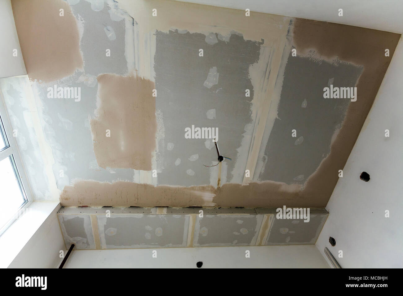Room under repair or building of new house or apartement. Suspended ...