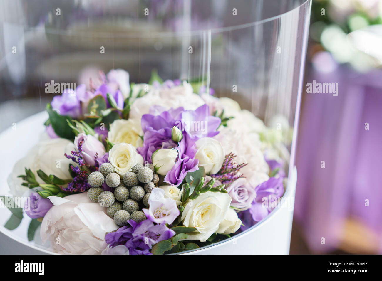 Flower in transparent plastic box. Brides wedding bouquet with ...