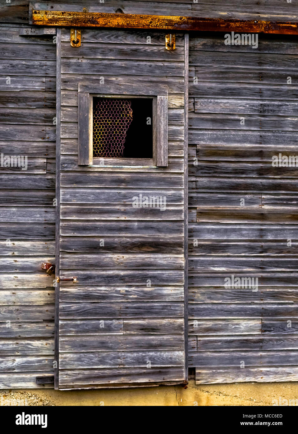 Sliding Barn Door On Rollers And A Rail Stock Photo 179748085 Alamy