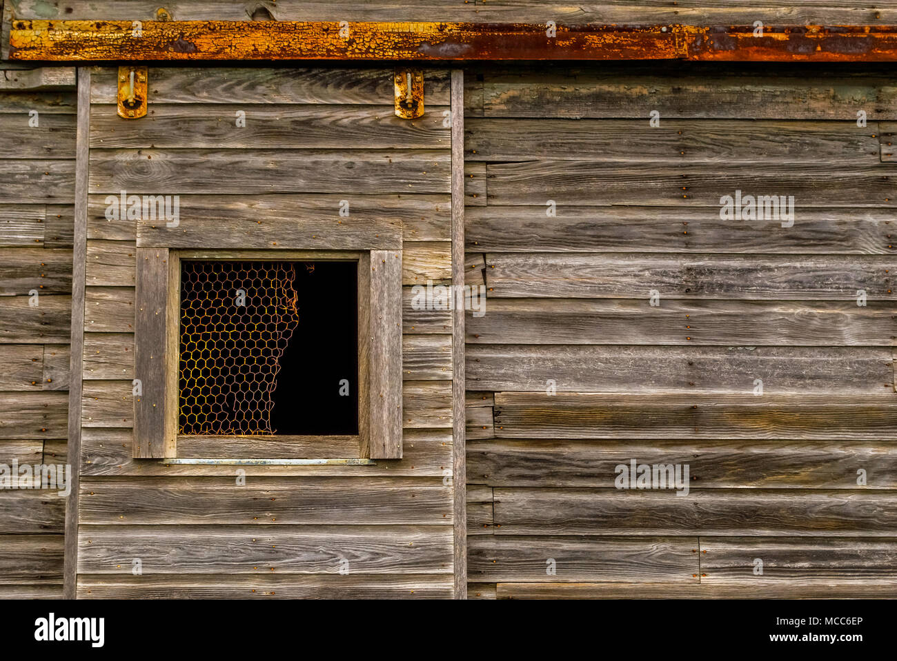 Sliding Barn Door On Rollers And A Rail Stock Photo 179748094 Alamy