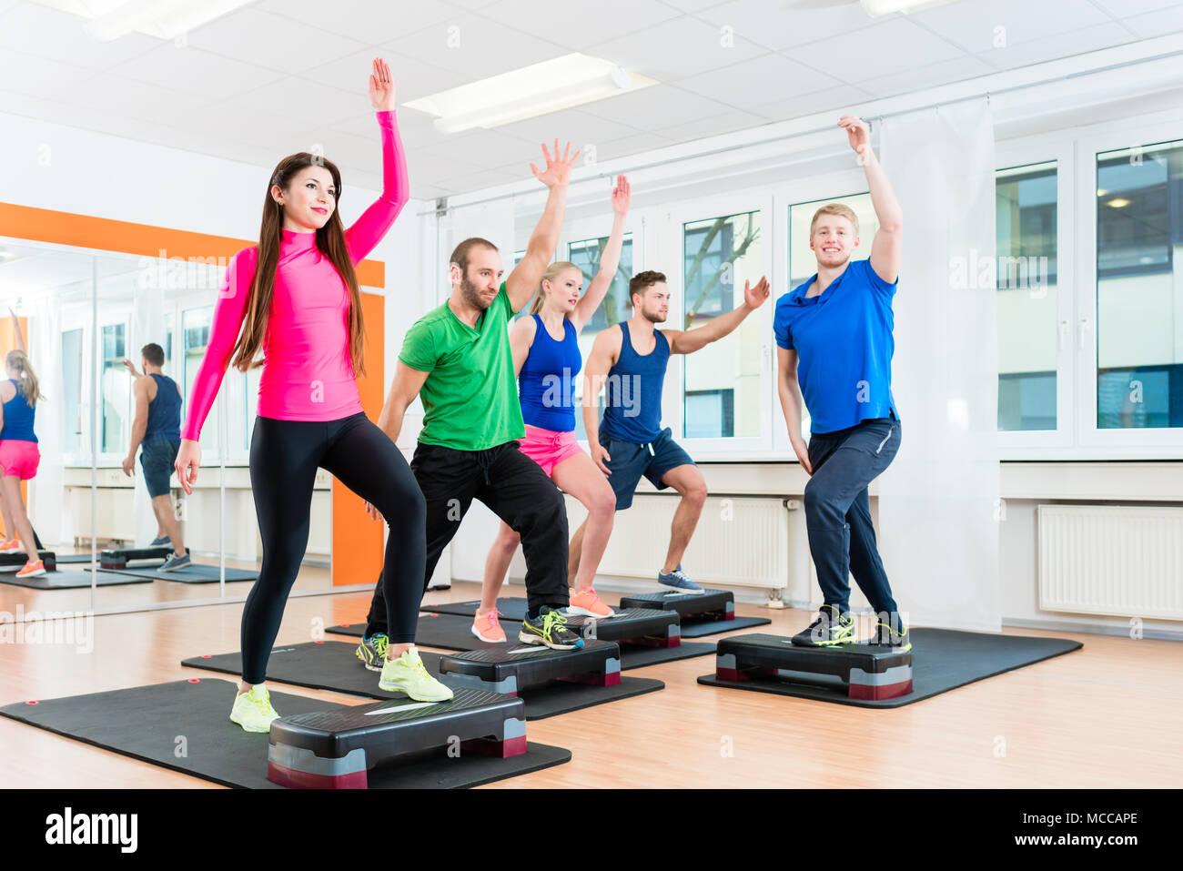men and women doing step aerobics at gym stock photo 179751446 alamy