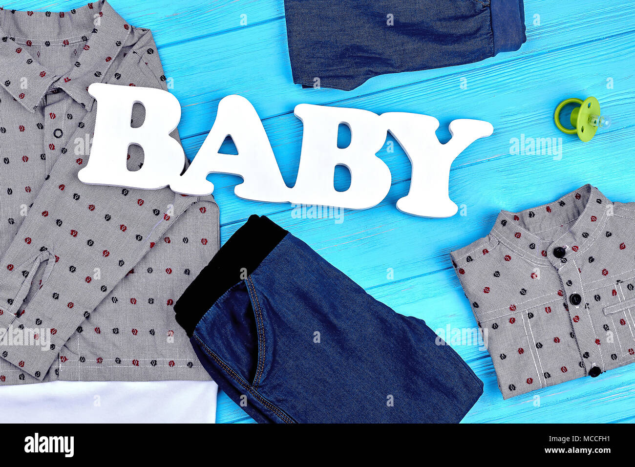 baby-boy brand clothes background. high quality denim apparel for
