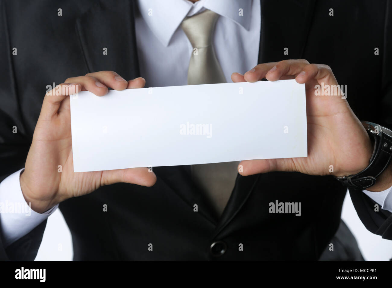 close up of business man holding white blank card with copyspace ready for your text or letters isolated on white background