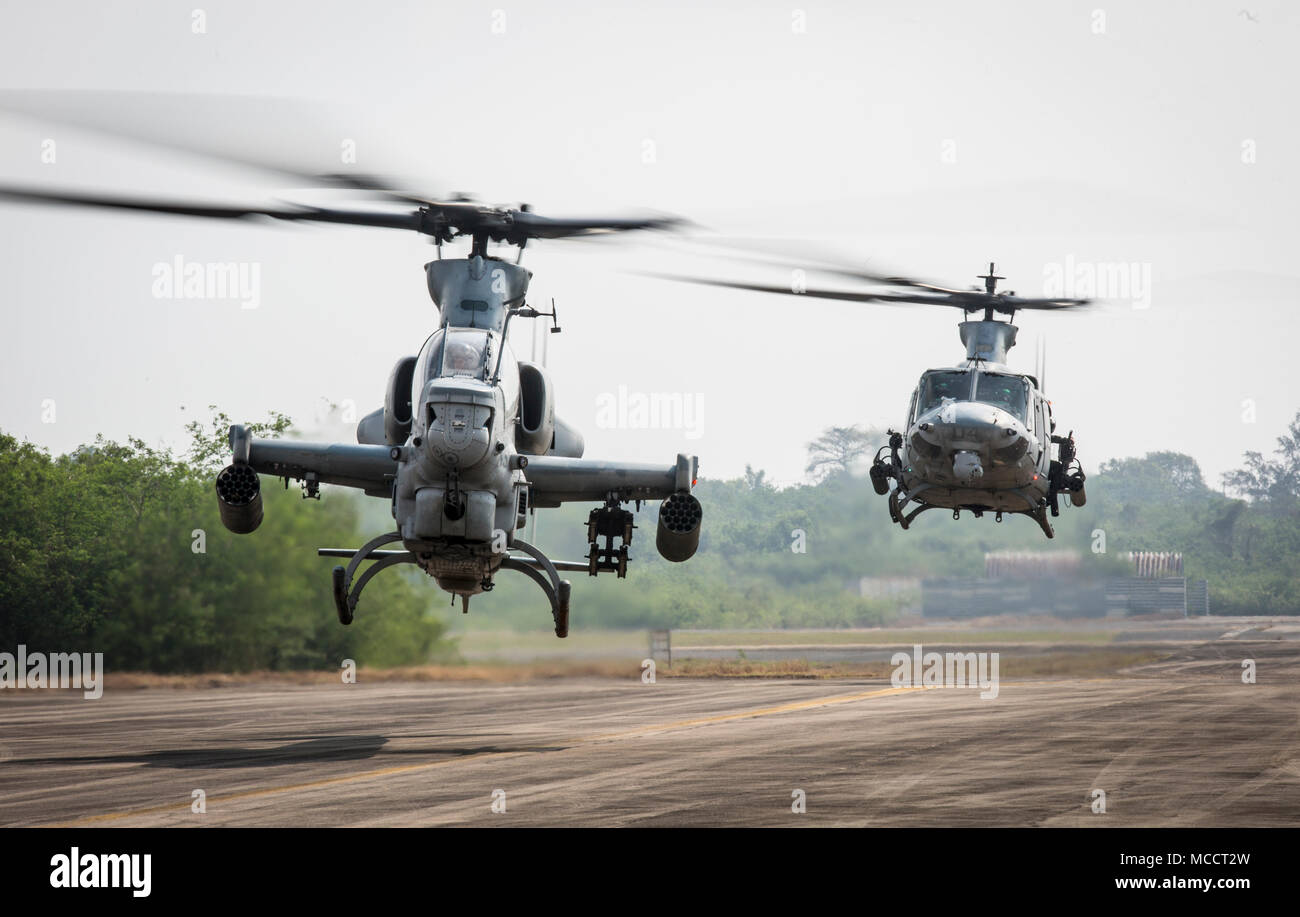 A us marine corps ah 1z viper helicopter foreground and a uh 1y a us marine corps ah 1z viper helicopter foreground and a uh 1y venom helicopter lift off the runway at u tapao international airport publicscrutiny Images