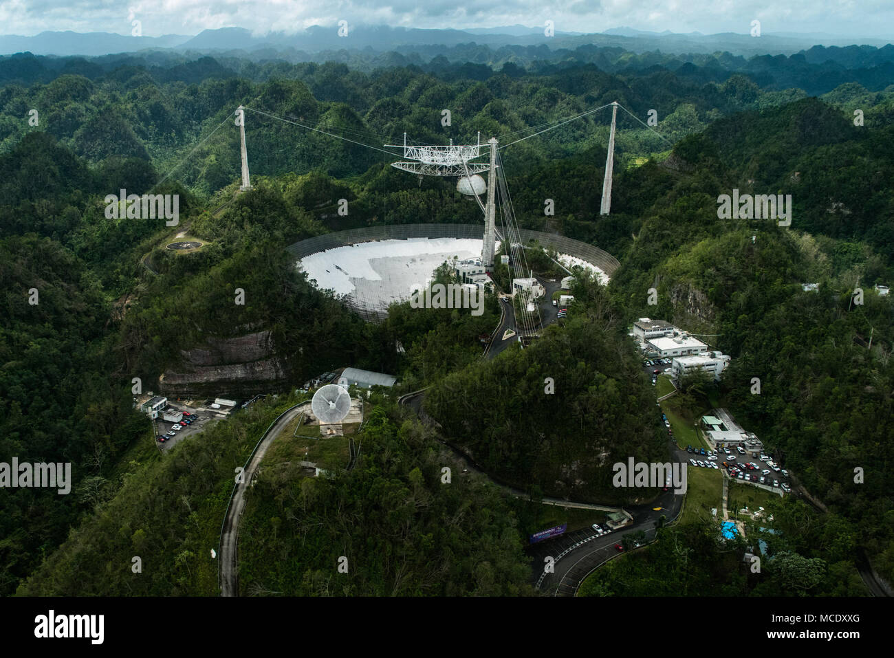 Bayamon, Puerto Rico, Feb. 13, 2018—FEMA Region VII personnel, Region VII Administrator Paul Taylor, and FEMA personnel from the Joint Field Office take an aerial tour of infrastructure damaged by Hurricanes Irma and Maria last September. The Radio Telescope at the Arecibo Observatory is facing months of costly repairs. FEMA/K.C. Wilsey Stock Photo