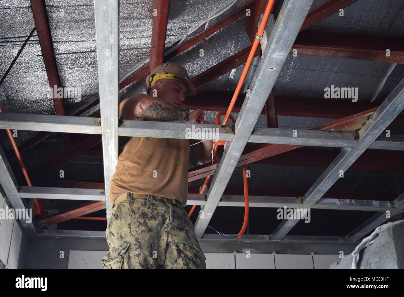 180220 N No181 0323 Palawan Philippines Feb 20 2018 Electrical Wiring Junction Box Attic 3rd Class Isiah Gotz Assigned To Naval Mobile Construction Battalion Nmcb 4 Connects Wires In An Overhead The Latrine