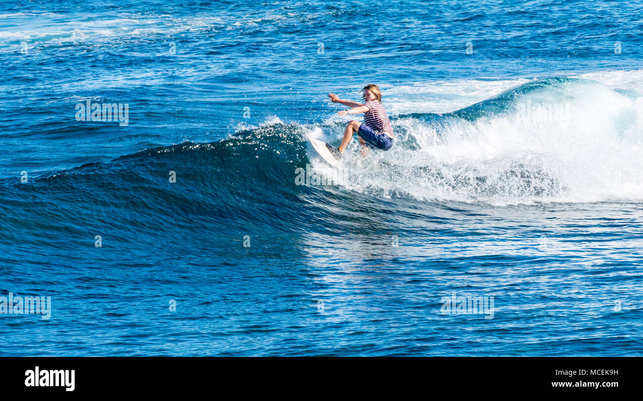 caucasian-man-with-long-hair-surfing-wav