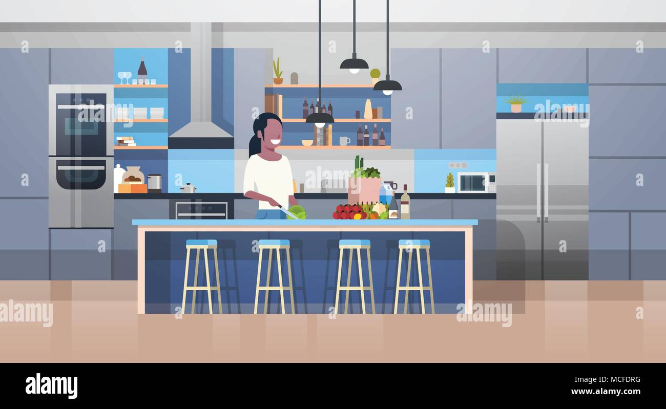 Modern Kithcen Interior And Young African American Woman Cooking ...