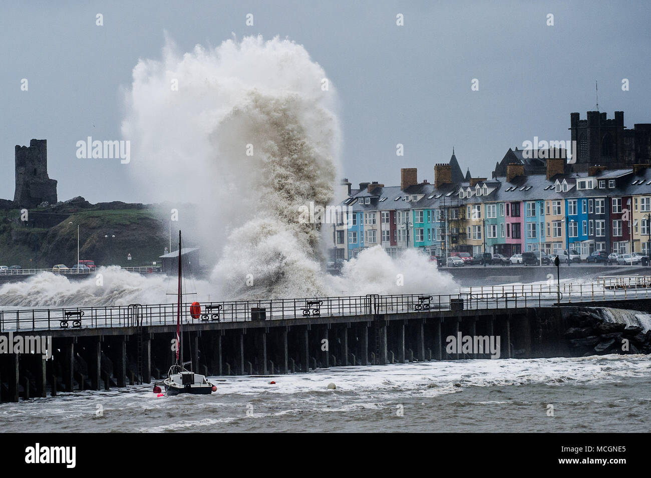 Aberystwyth Wales UK, Tuesday 17  April 2018  Strong gale force winds  from the south west, and a 5.3m high tide,  combine to generate huge waves  battering the seafront and harbour in Aberystwyth on the west coast of Wales this morning   photo © Keith Morris / Alamy Live News Stock Photo