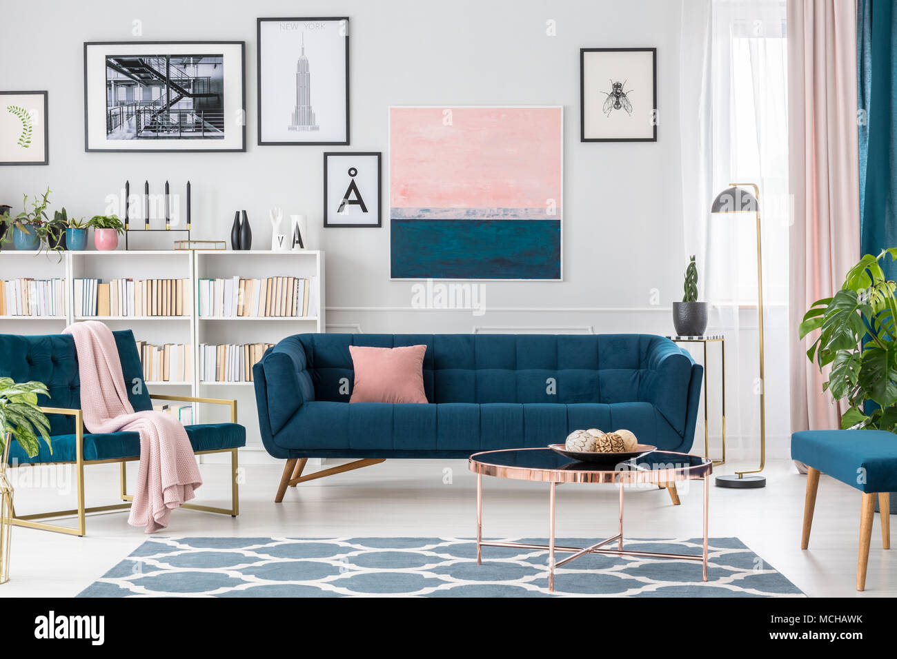 Modern Living Room Interior With Blue Sofa, Rug, Art Collection And Pink  Details
