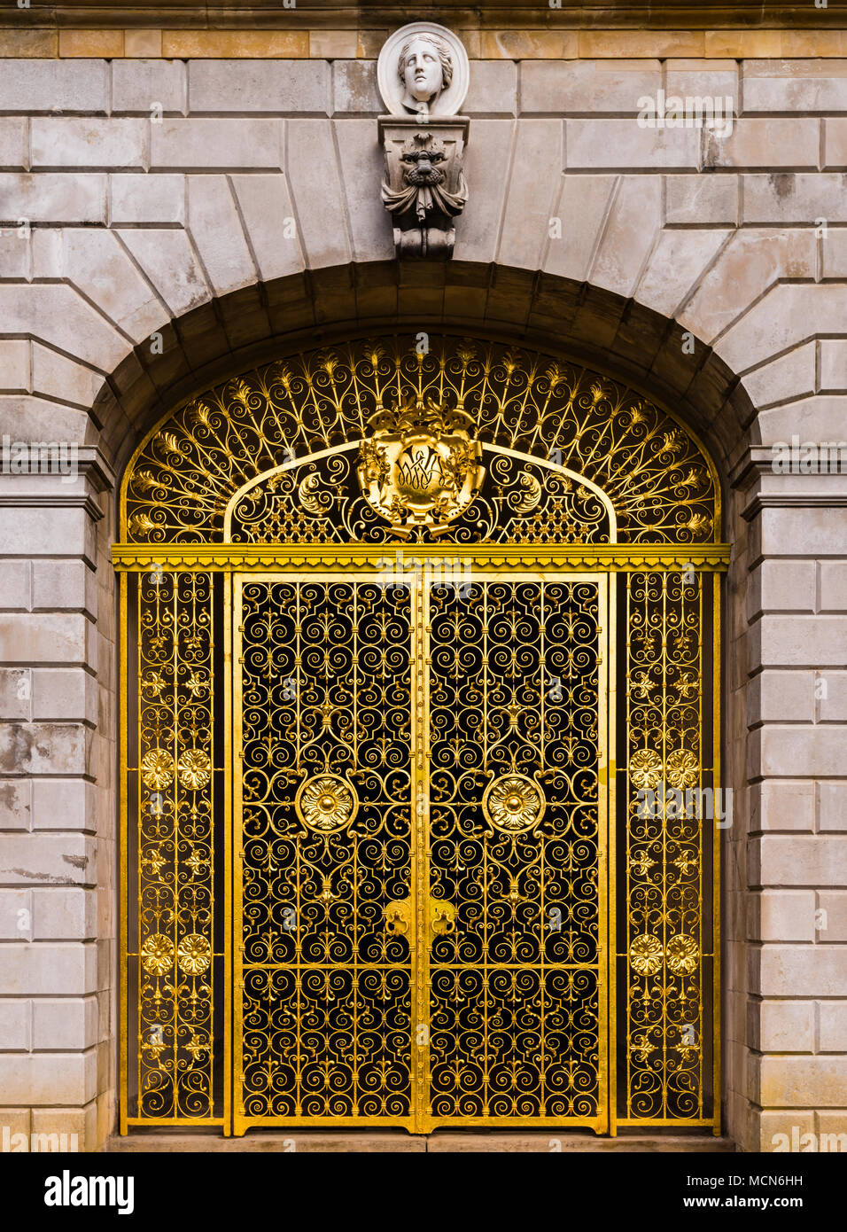 Golden gates at Cliveden House, Buckinghamshire, UK - Stock Image