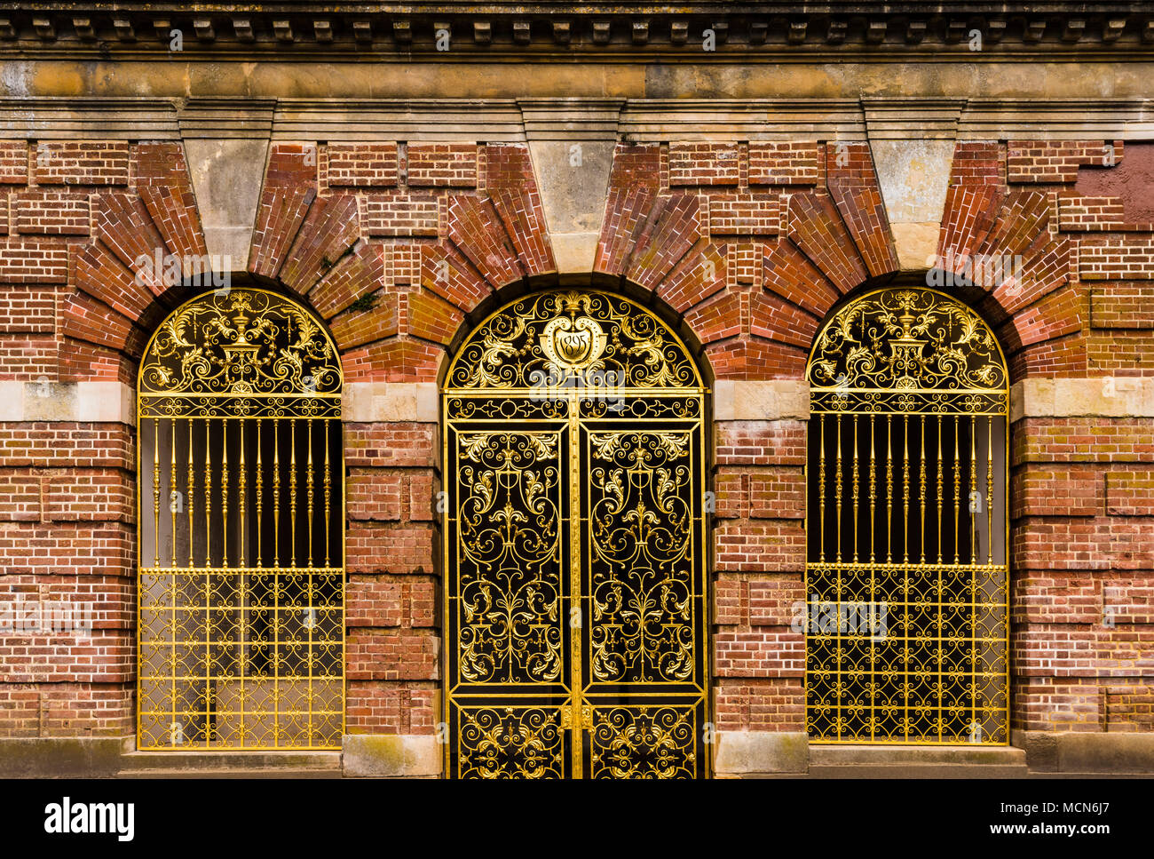 Three golden gates at Cliveden House, Buckinghamshire, UK - Stock Image