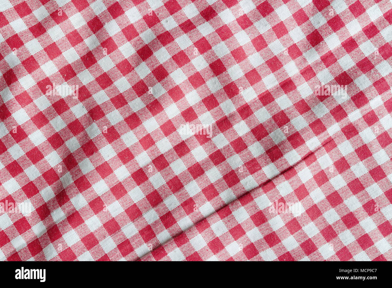 42a83cd79e9 Red linen picnic tablecloth. Texture of a red and white checkered picnic  blanket.