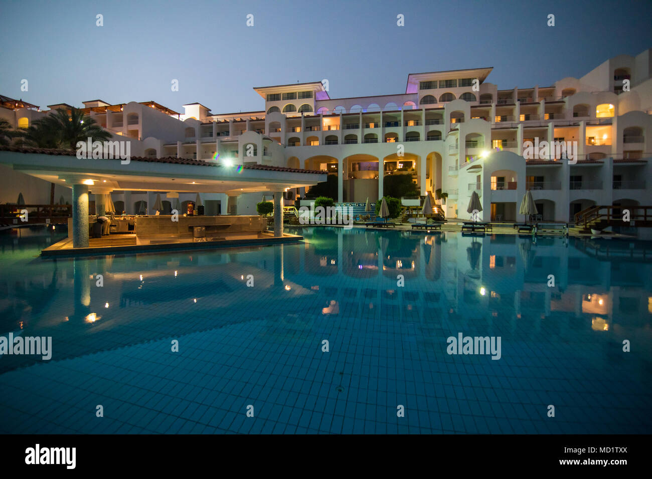 Night Illumination In Luxury Hotel With Swim Pools At Spa And Sea