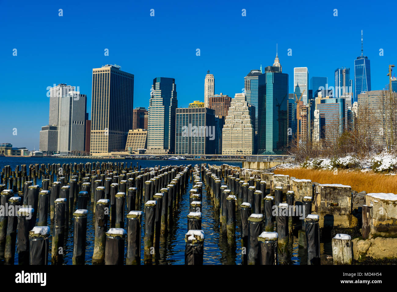 Lower Manhattan Skyline Panorama In Snowy Winter Time From Brooklyn