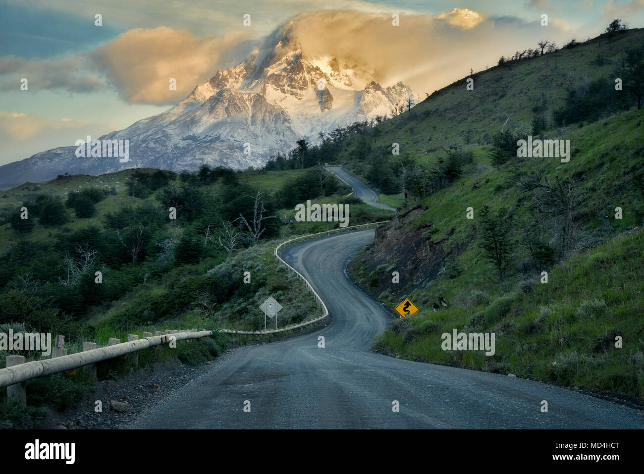 Paine Massif mountains  and road at sunrise . Torres del Paine National Park, Chile, Patagonia - Stock Image