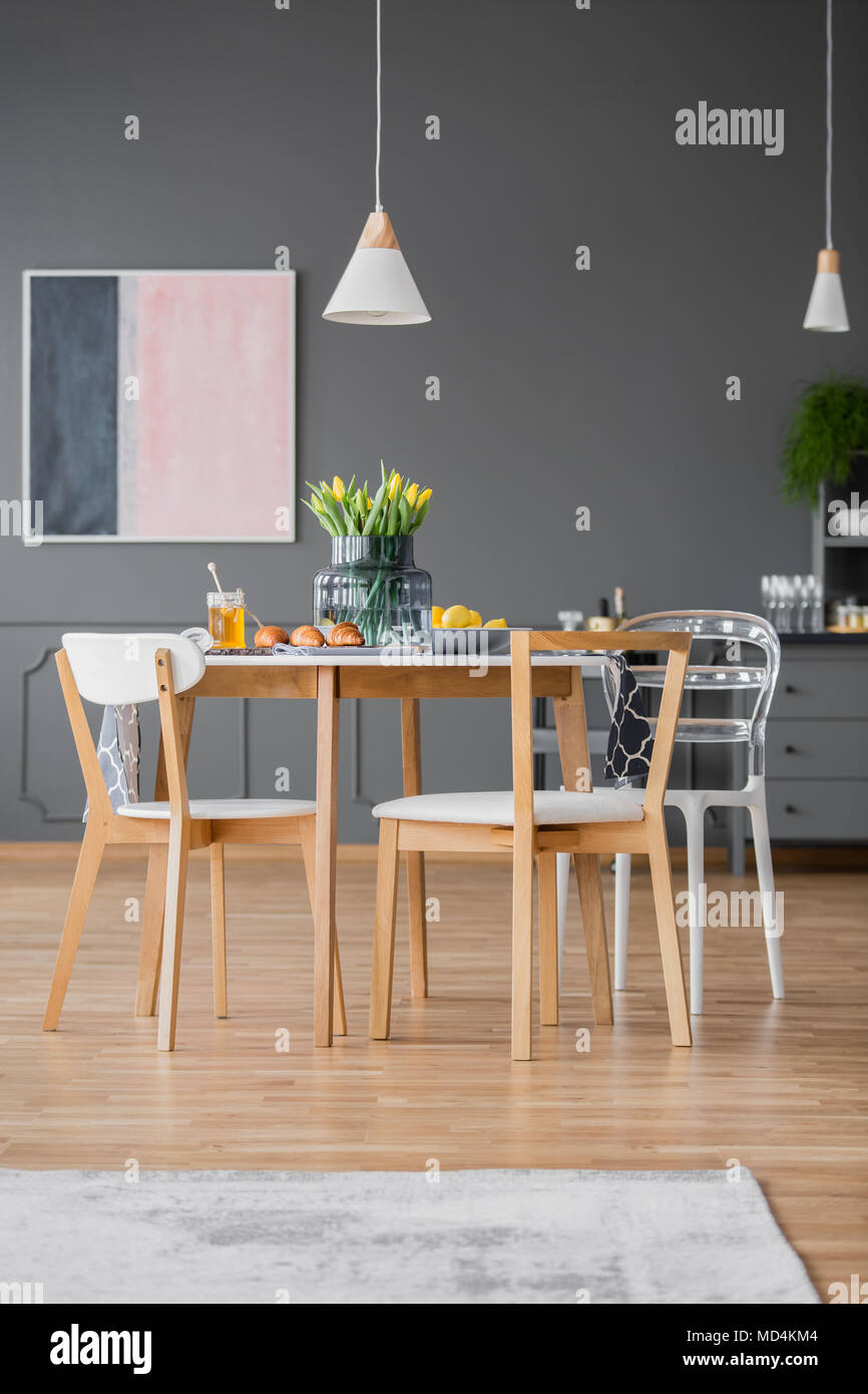 Creative Design Modern Dining Chairs Around A Simple Kitchen Table With A  Tablecloth In A Gray Open Space Apartment Interior