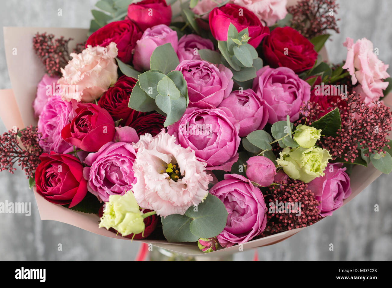 Close up beautiful bouquet spring flowers on gray background close up beautiful bouquet spring flowers on gray background flower shop wooden table izmirmasajfo