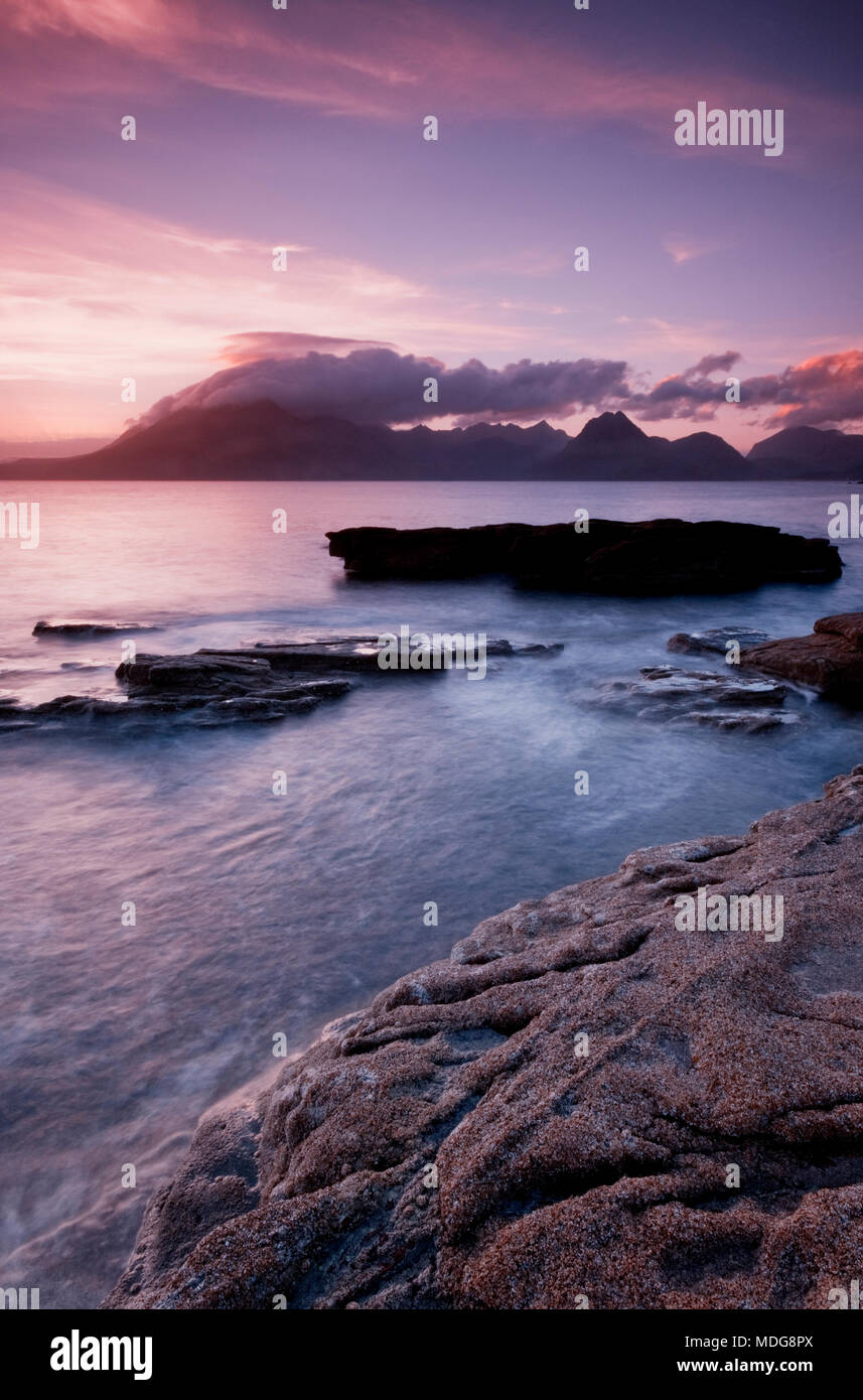 Sunset over the Cuillin mountains viewed from Elgol on the Isle of Skye, Scotland, UK - Stock Image
