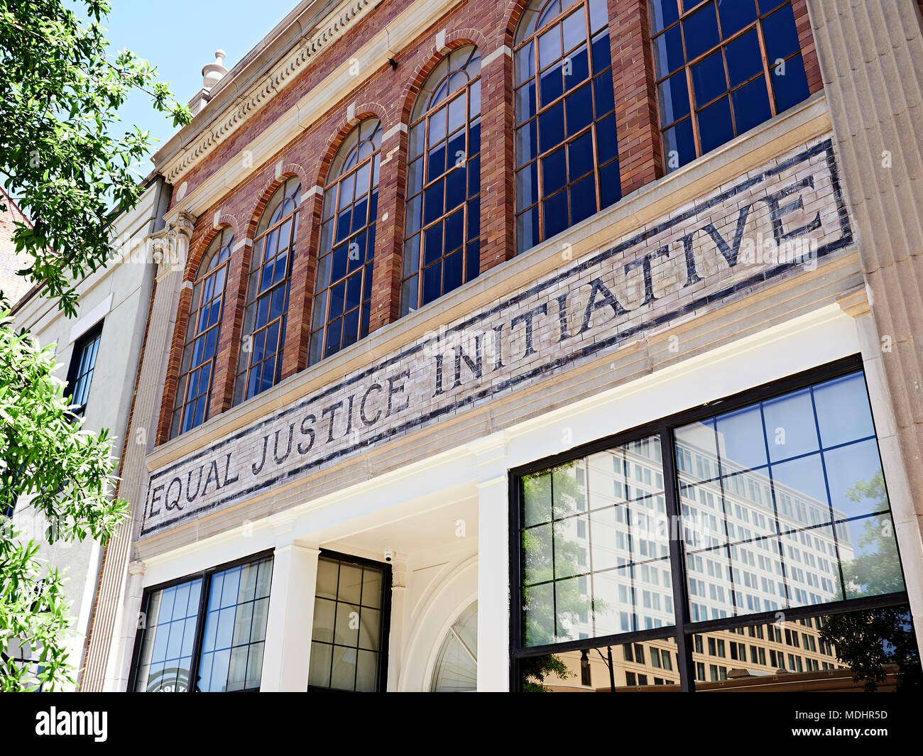 Equal Justice Initiative sign above the exterior entrance to the building and offices in Montgomery Alabama, USA. - Stock Image