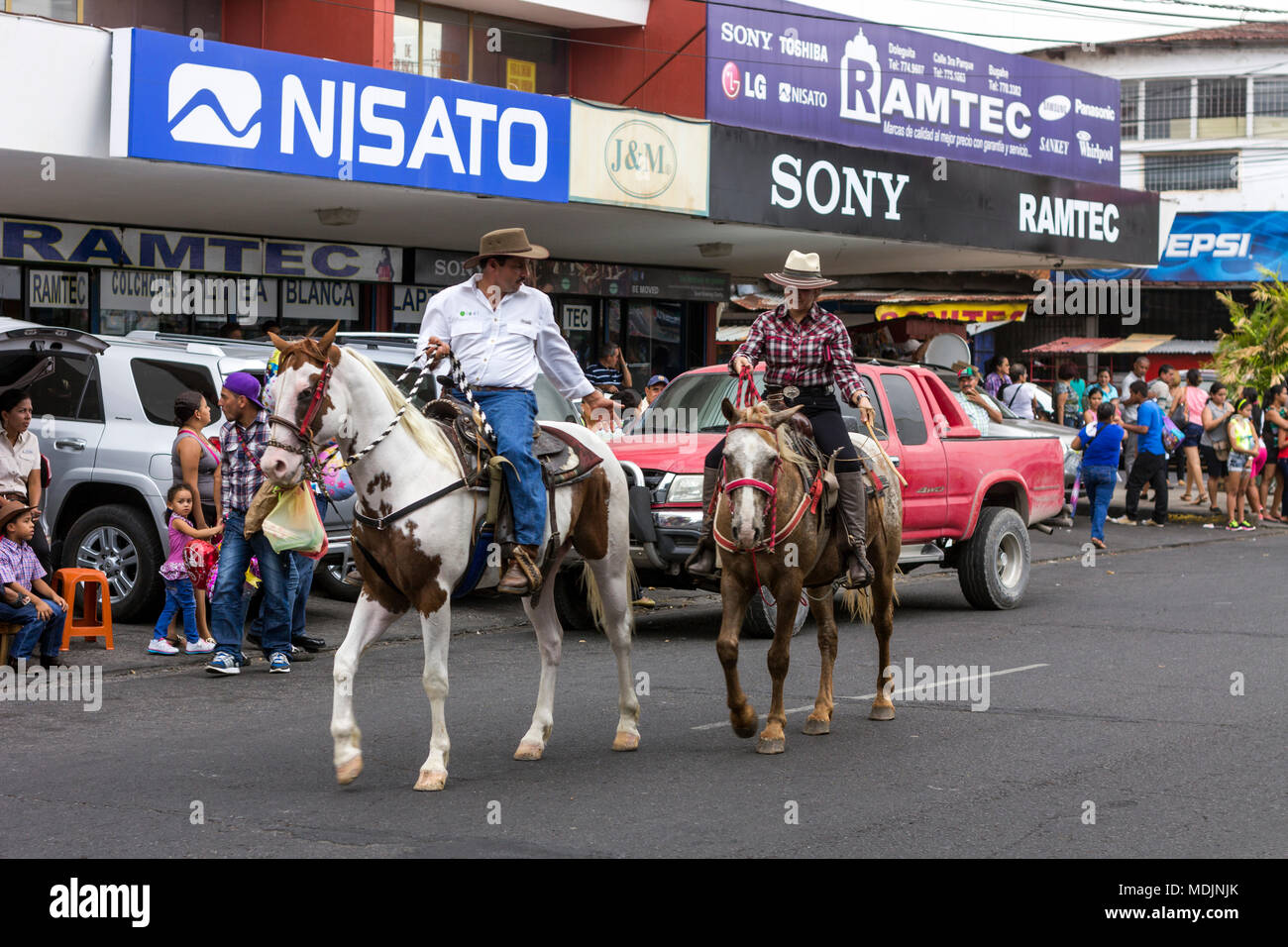 Horses and riders parade through the streets of David, Panama, in the  annual Cabalgata