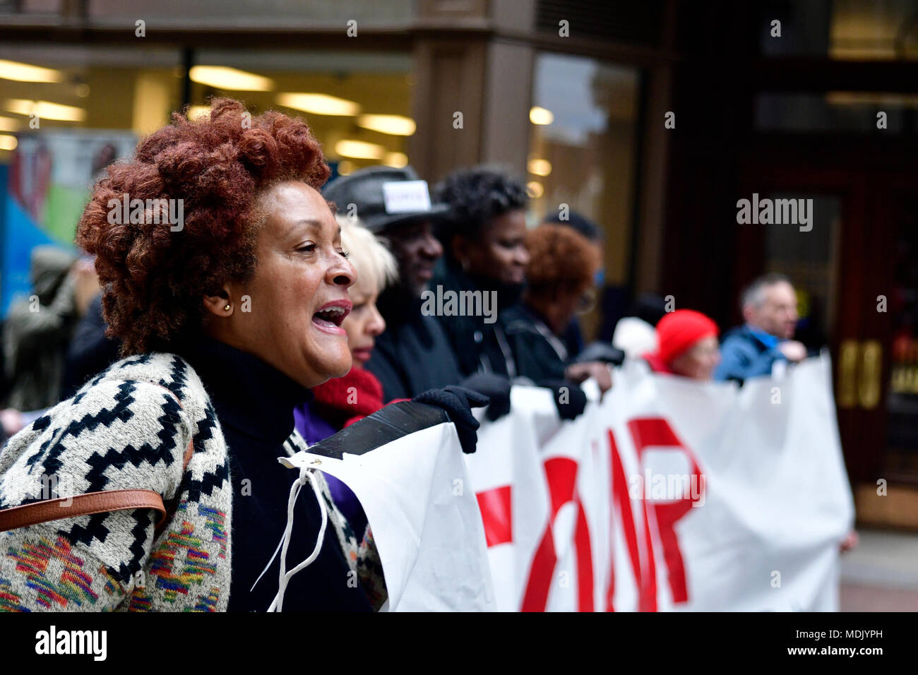Philadelphia, USA. 19th Apr, 2018. Community members join religious leaders and clergymen with Philadelphians Organized to Witness, Empower and Rebuild (POWER) hold a Police Accountability rally, followed by a protest march starting at Philadelphia Police Dept. headquarters and ending at City Hall in center City Philadelphia, PA, on April19, 2018. The protest is a reaction to the recent controversial arrest at a Center city Starbucks of two black men. Credit: Bastiaan Slabbers/Alamy Live News - Stock Image