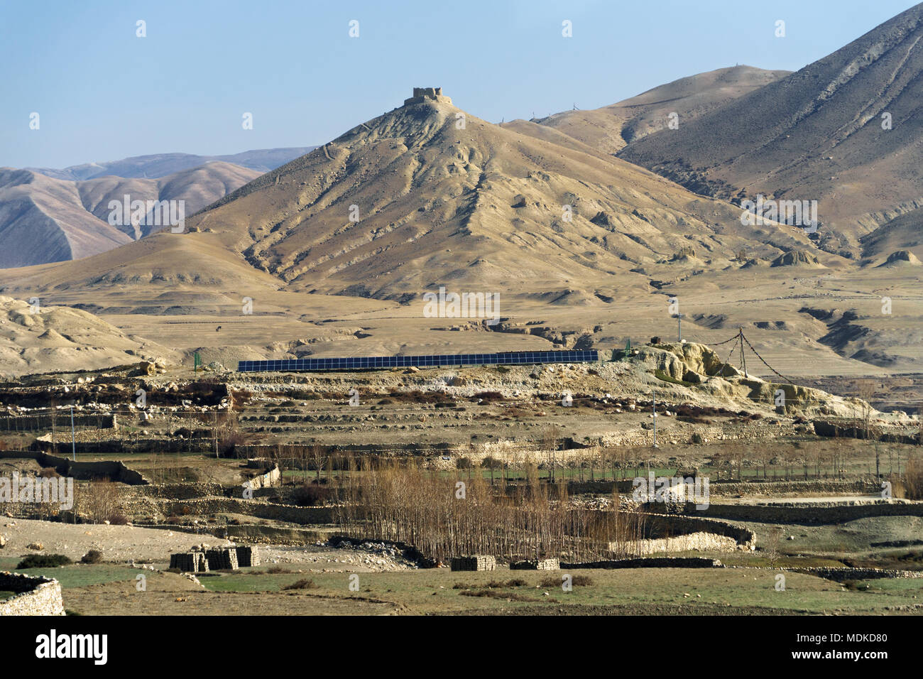 Ruins of Ame Pal's palace overlooking Lo Manthang, Upper Mustang region, Nepal. Double row of solar panels visible in the foreground. - Stock Image