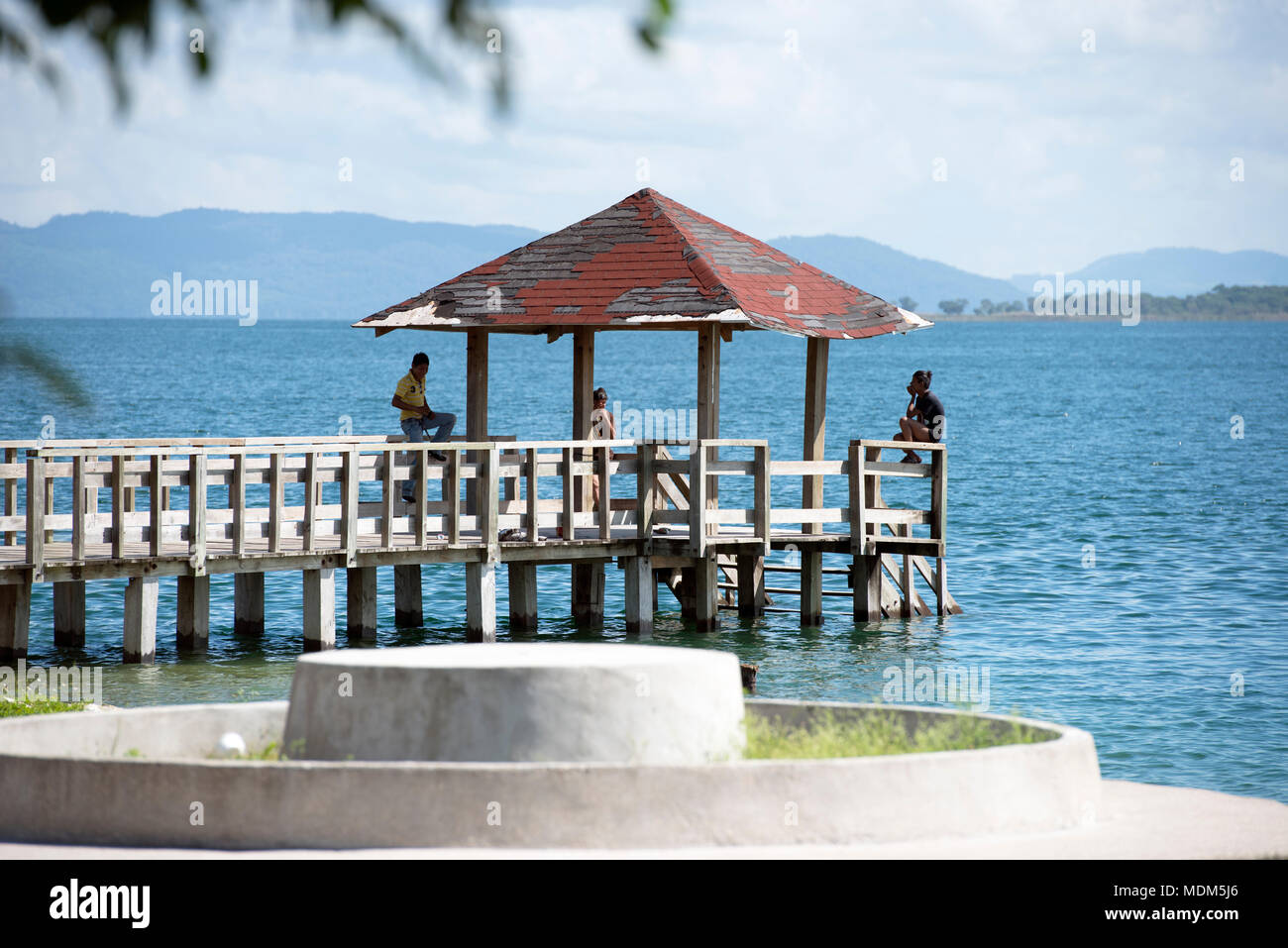 Young Itza people, descendants of the ancient Maya, relax on a sunny afternoon by Lake Peten in northern Guatemala. - Stock Image