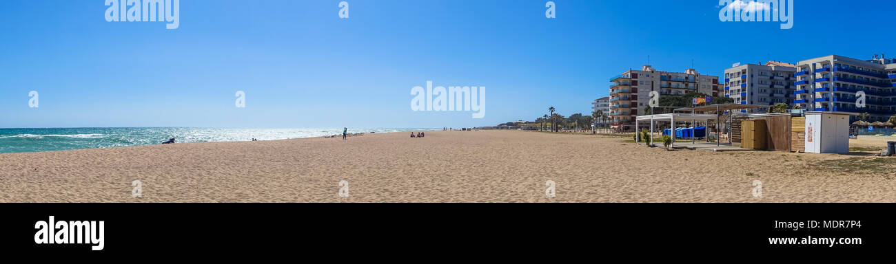a-panoramic-view-of-a-quiet-empty-sandy-beach-at-santa-susanna-on-the-costa-brava-region-of-spain-MDR7P4.jpg