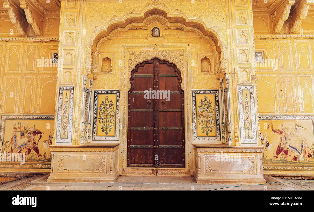 Ancient wooden door with vintage wall art on the entrance gate of ...