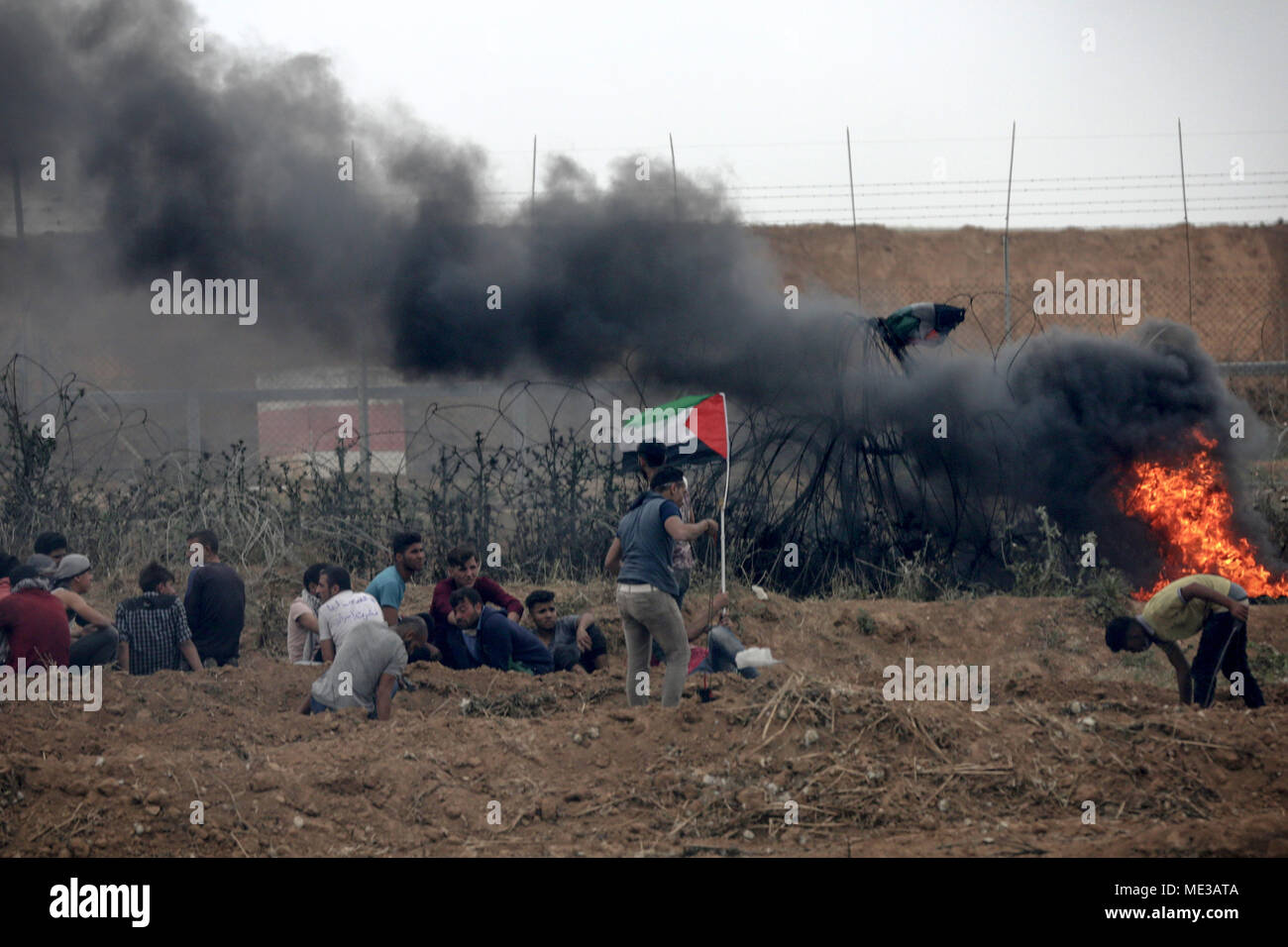 A Palestinian Protester Throw Stones During Clashes Near The Border